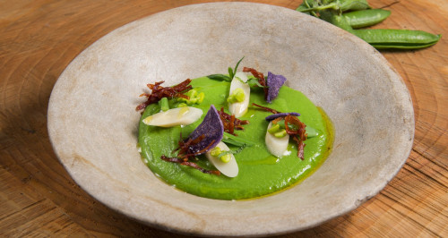 Chilled pea purée with mint, crispy prosciutto crudo and hearts of palm