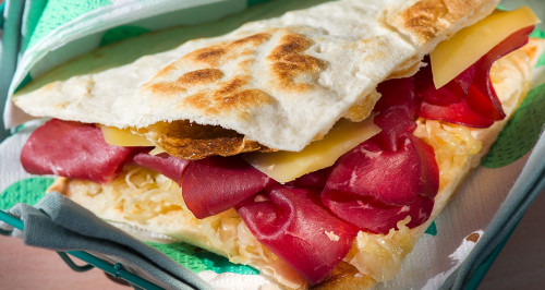 Piadina with bresaola, aioli, bitto cheese and sauerkraut