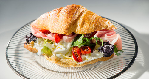 SAVOURY CROISSANT WITH SAN DANIELE HAM, BAKED TOMATOES, STRACCIATELLA CHEESE AND LEMON PEEL