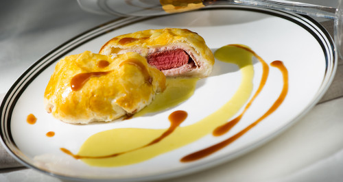 BEEF FILLET IN PUFF PASTRY CRUST WITH COOKED HAM ON FONTINA FONDUE