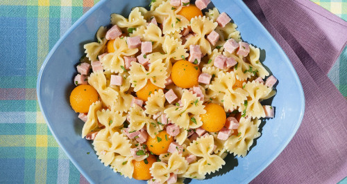 Cooked ham and melon bow tie pasta