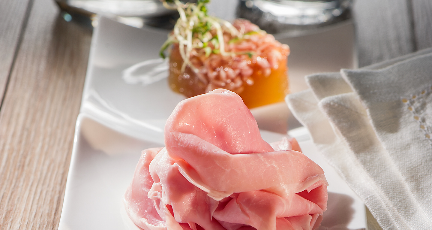 Italian-style starter: Russian salad with saffron, ham and meat gelatine