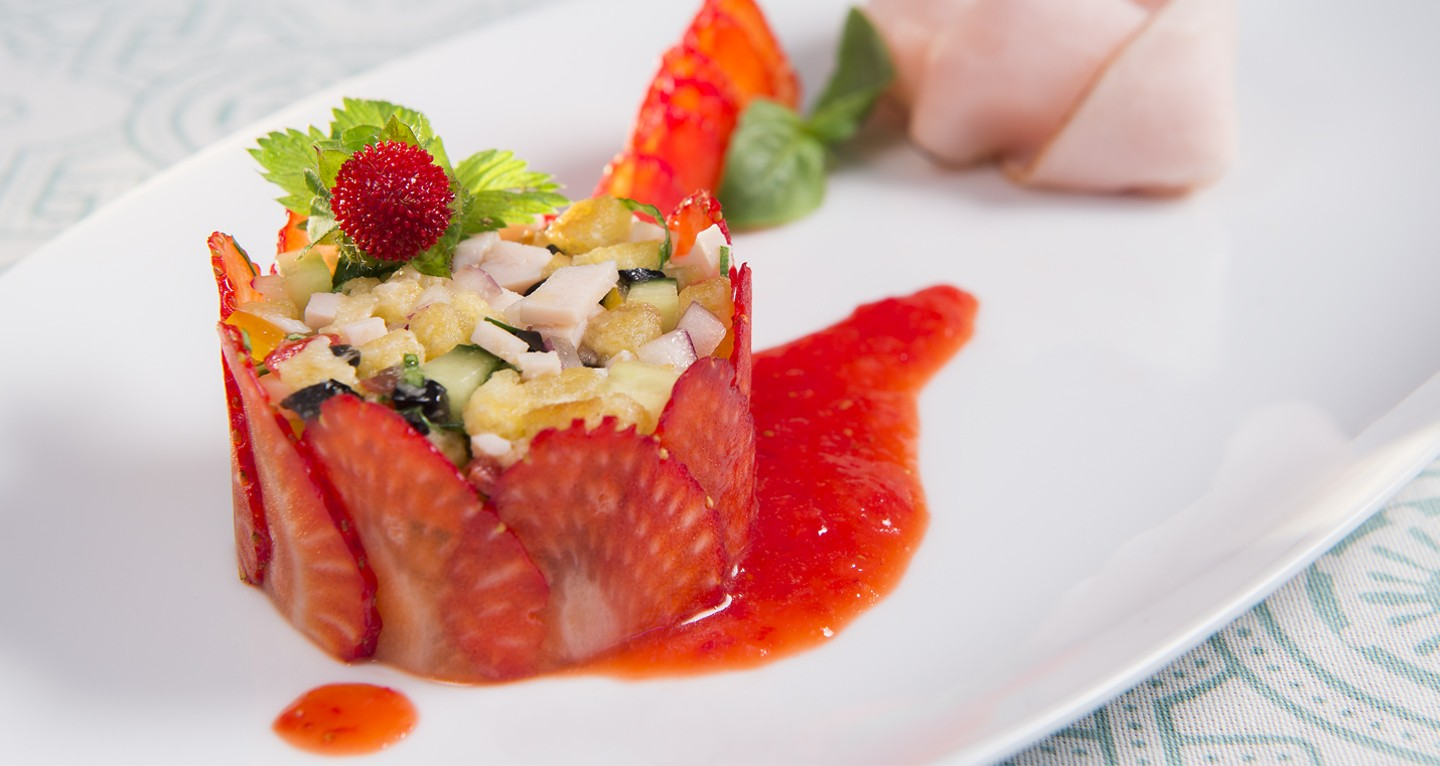Vegetable and turkey panzanella salad with strawberry coulis