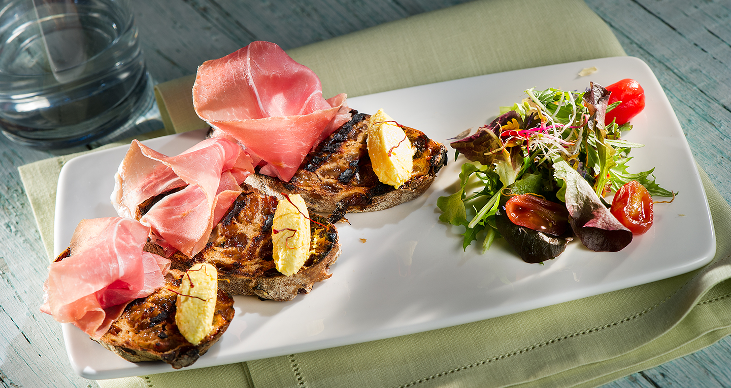 BRUSCHETTA OF RAISIN BREAD, SAN DANIELE HAM AND SAFFRON GOAT CHEESE