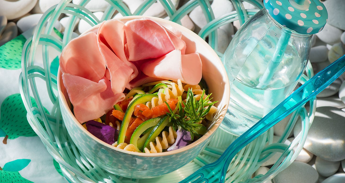 Salad of wholemeal pasta, cooked ham, smoked salmon and trumpet courgettes