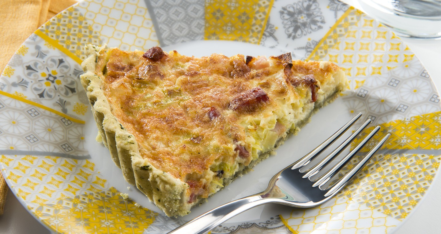 Quiche with basil shortcrust pastry, leeks, and diced bacon