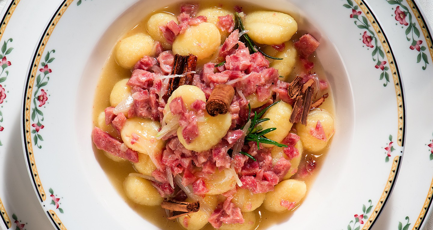 POTATO GNOCCHI AND WHITE RAGÙ SAUCE WITH COTECHINO, ROSEMARY AND CINNAMON