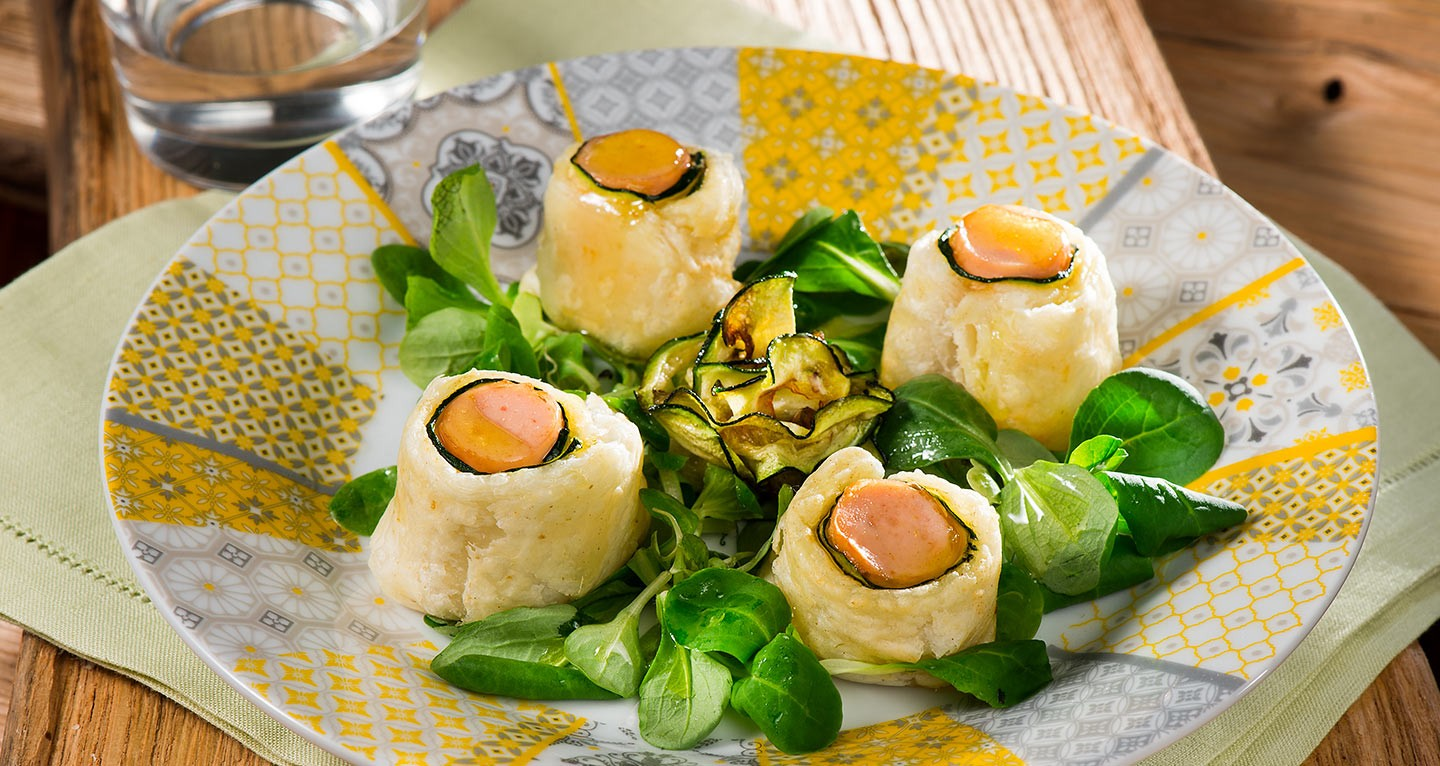 Chicken frankfurter roll with courgette on a bed of soncino salad